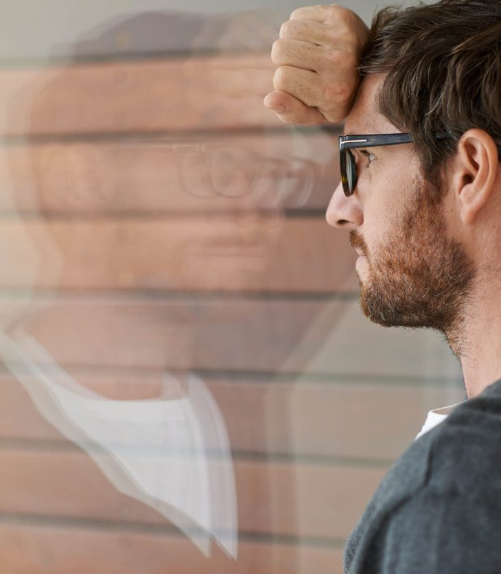 Man at window contemplating a career change