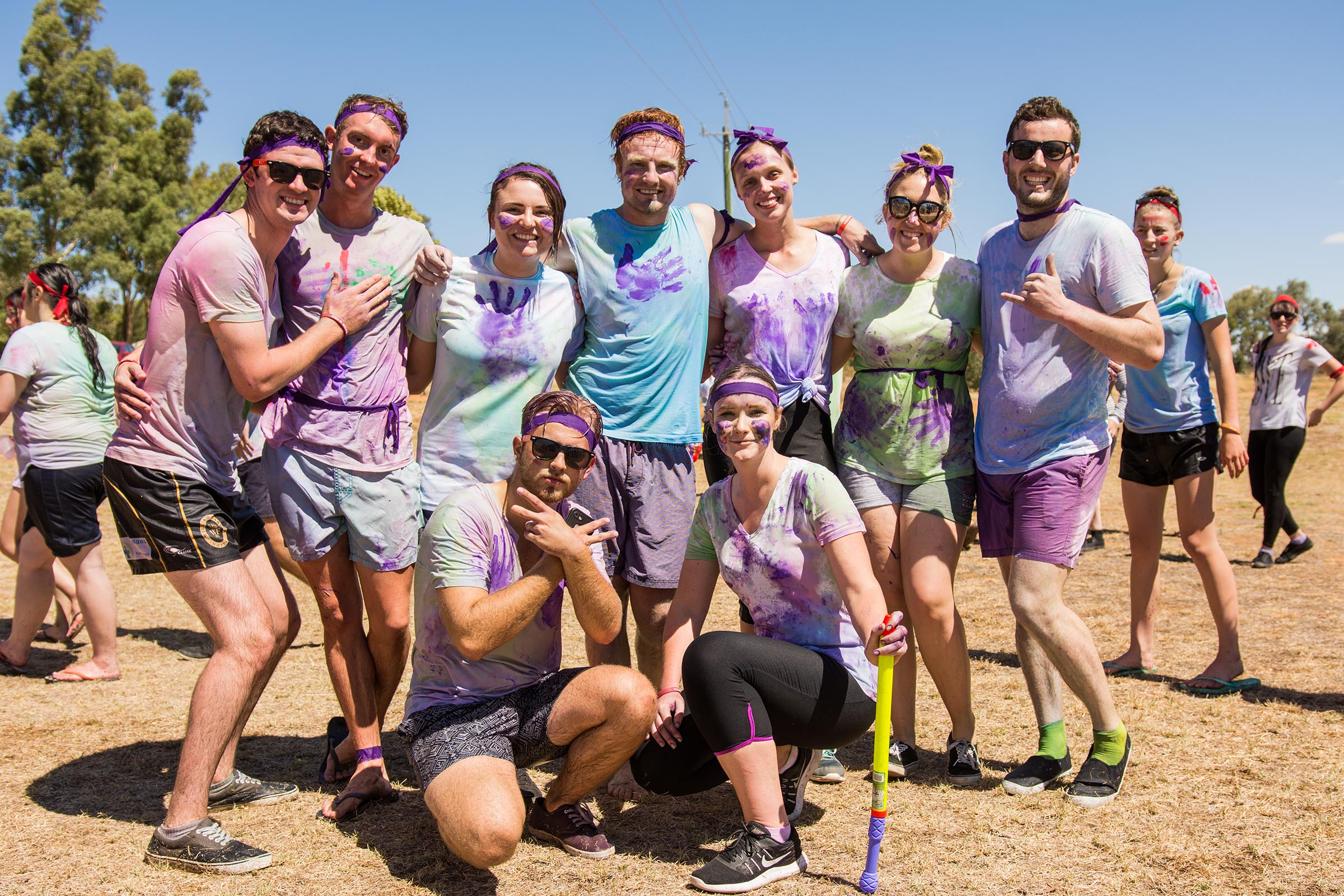 Group of university students covered in paint
