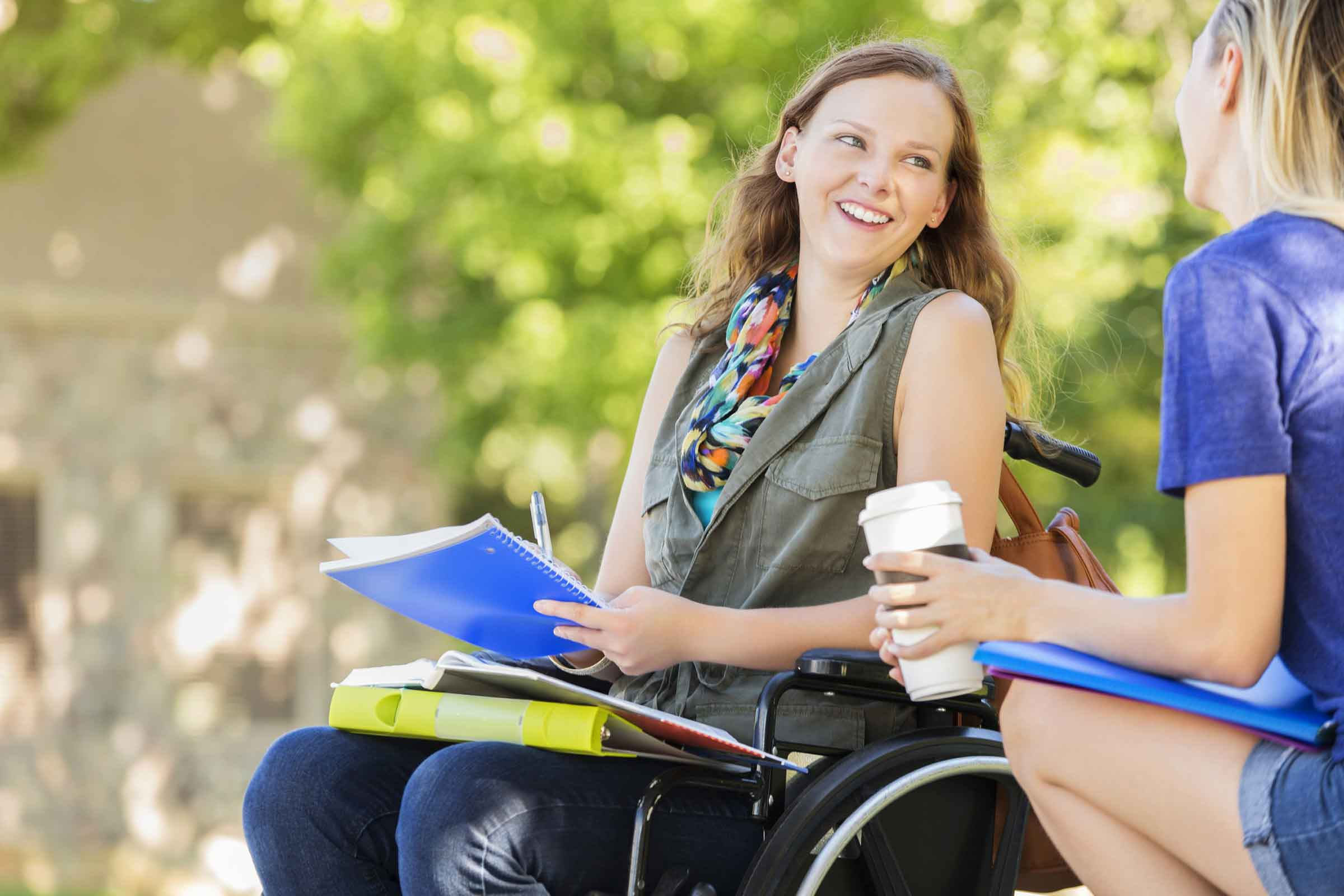 Women in wheelchair discussing the disability service