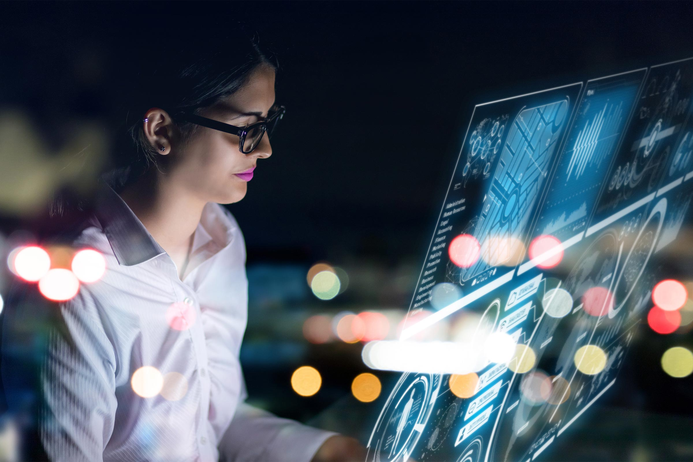 Young woman looking at holographic screen