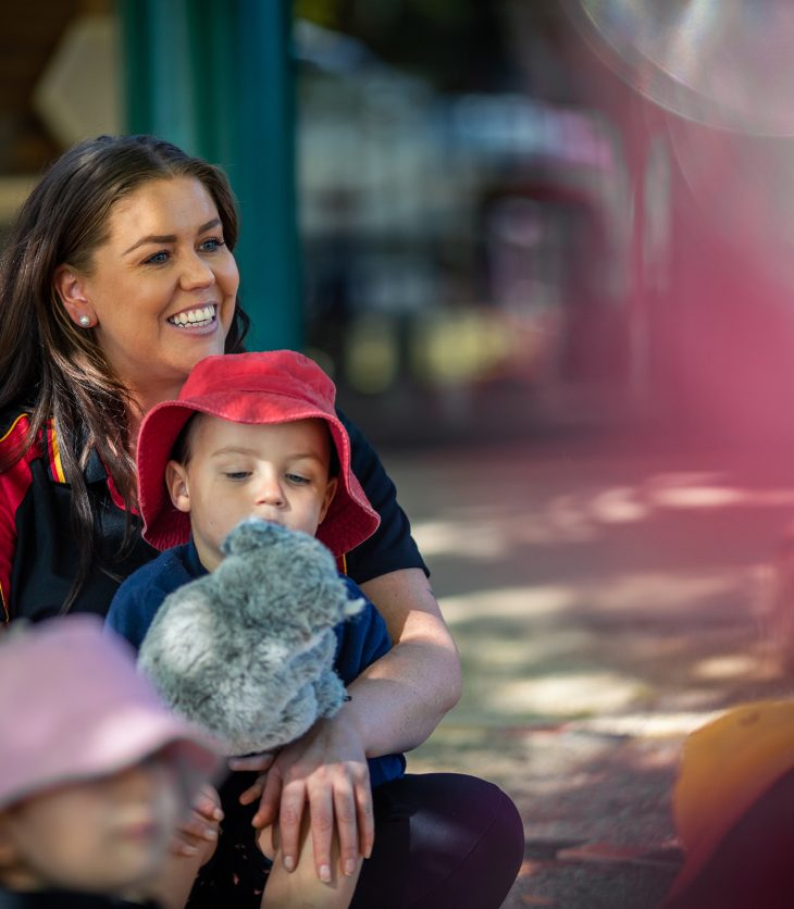 Courtney Glazebrook at Towri Multifunctional Aboriginal Children's Service, an Indigenous education provider, with a preschooler.