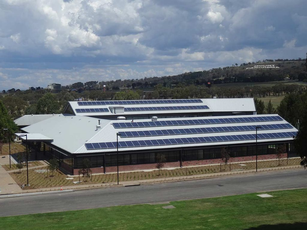 Aerial view of solar panels on the Bathurst campus' engineering building.