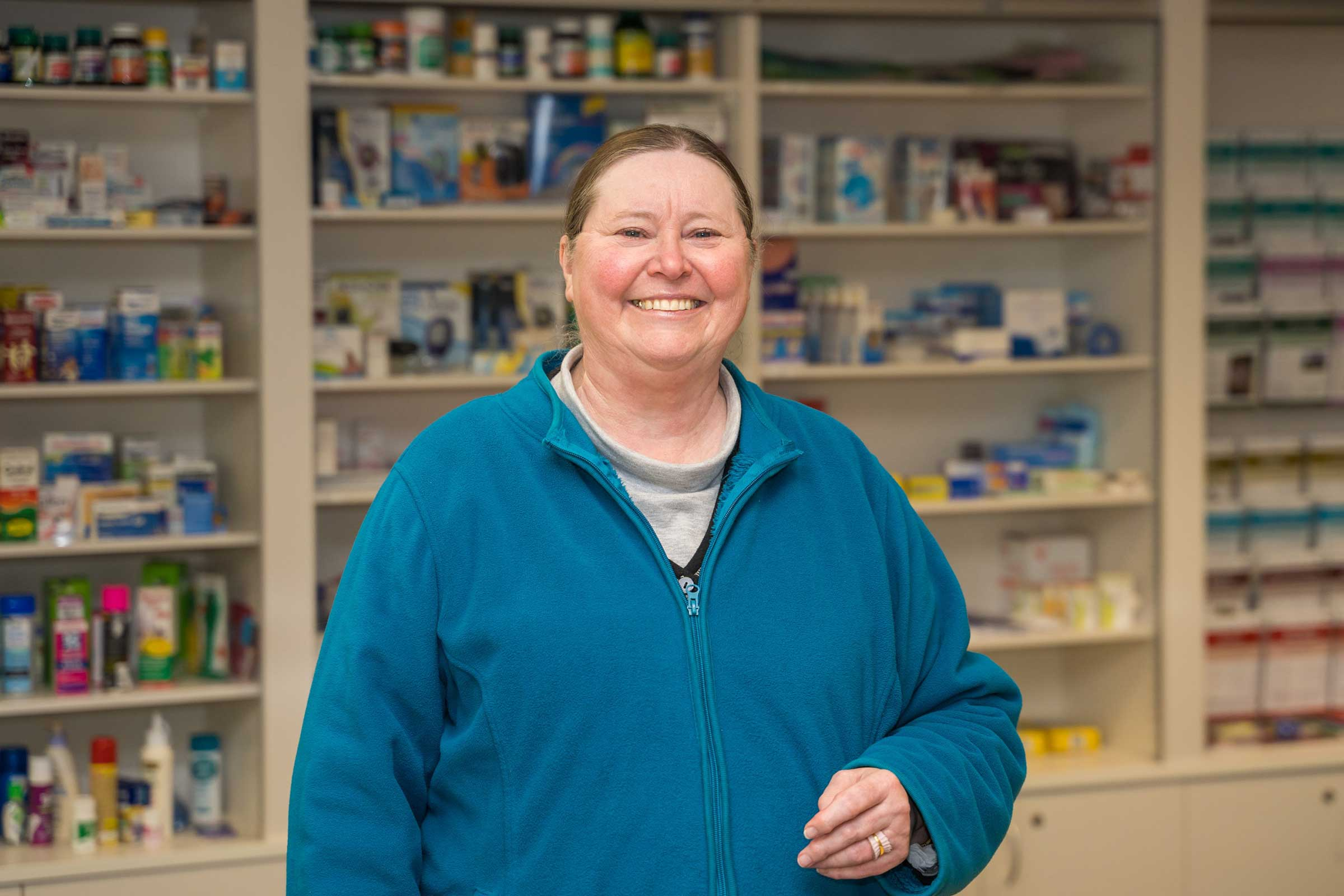 Mareer Donna Simpson standing in front of a pharmacy display