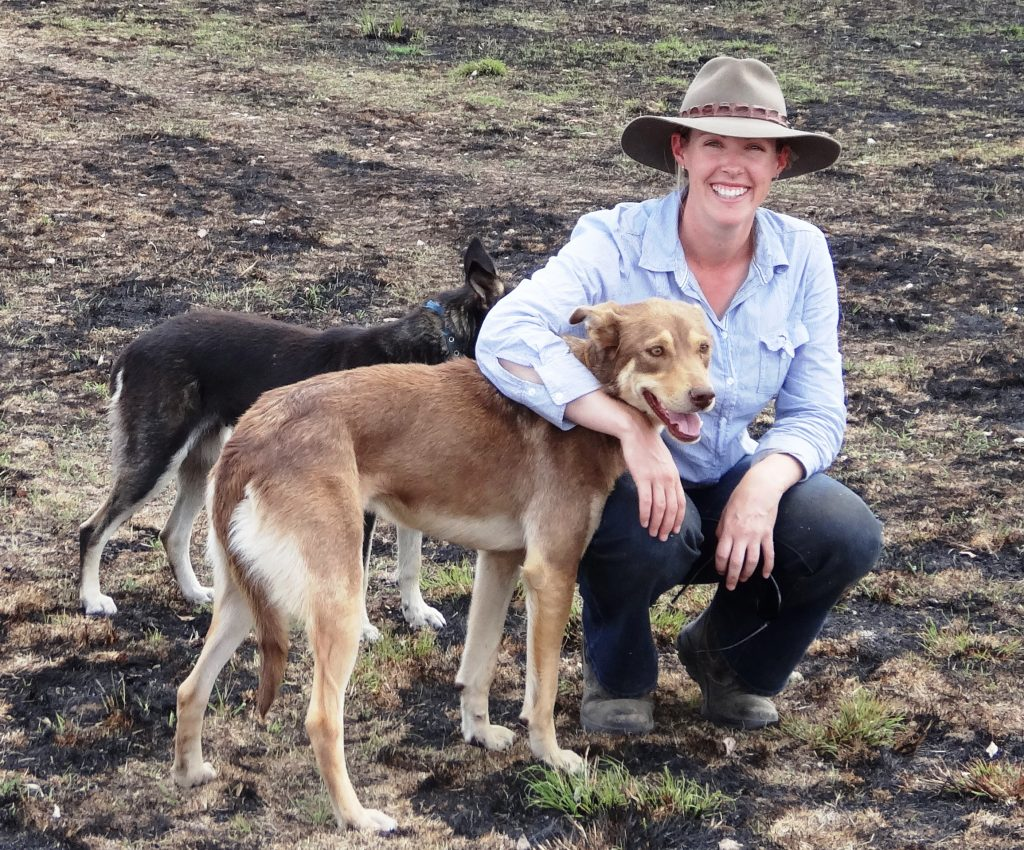 Dr Alison Southwell and her two dogs on the farm.