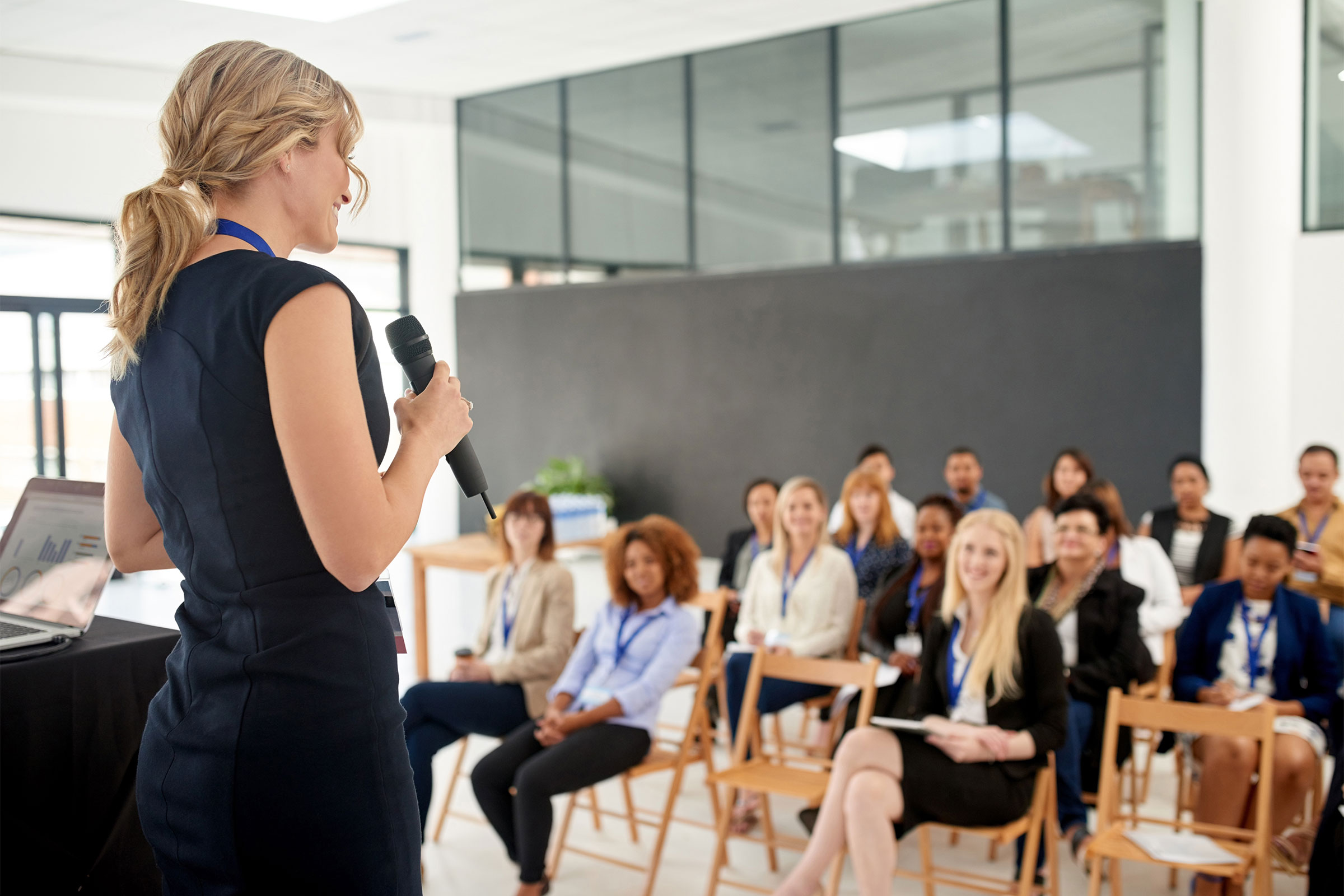 Woman addressing a roomful of people