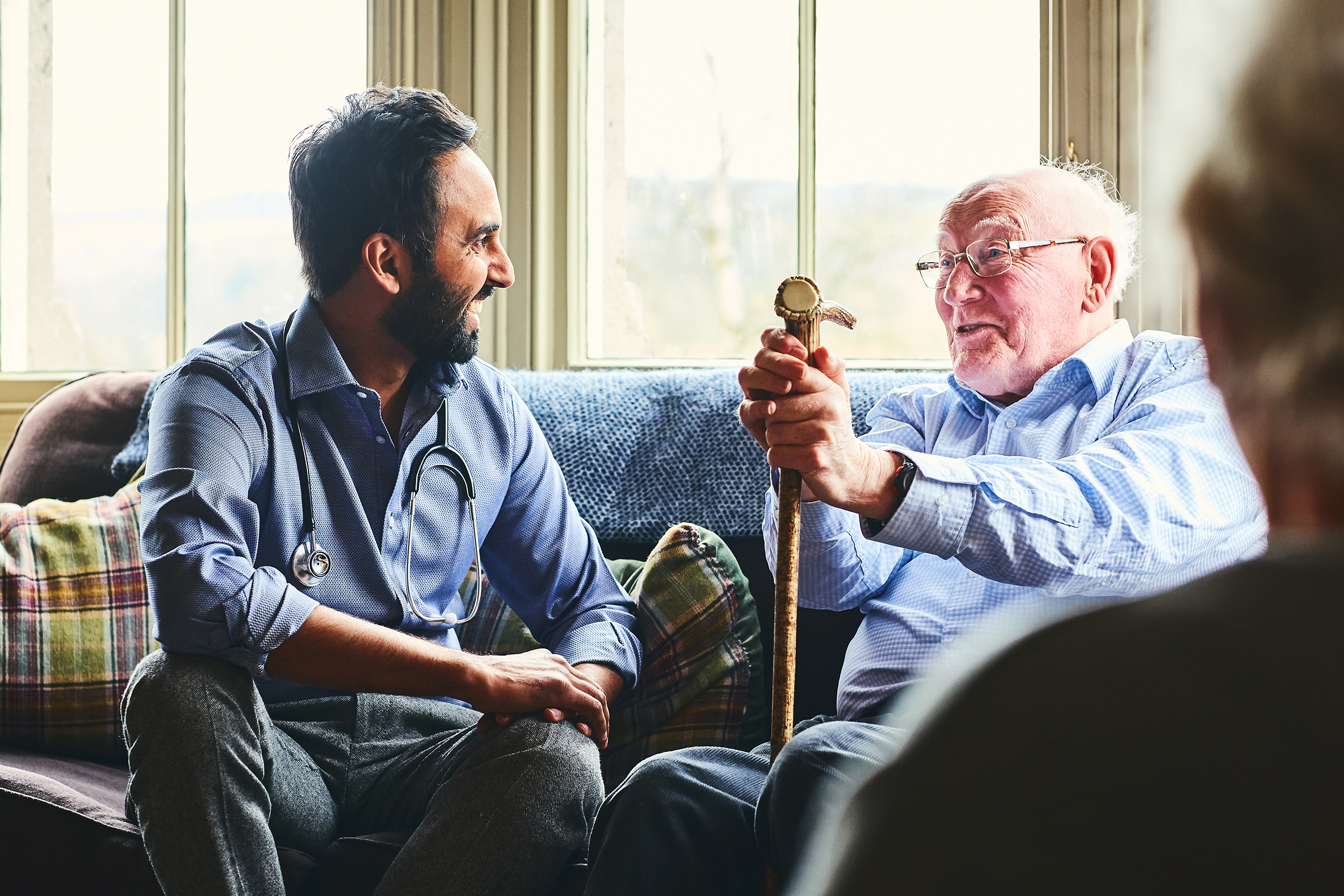 Doctor talking to an elderly man