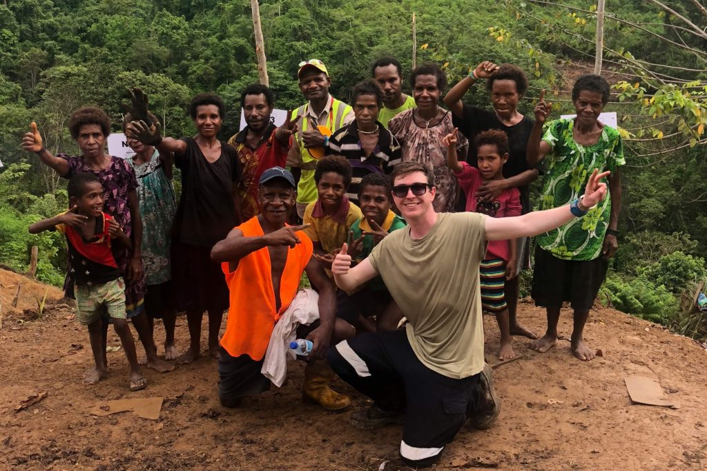 Charles Sturt student Dylan Male pictured with a group of Papua New Guineans.