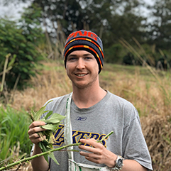 Charles Sturt student Dylan Male pictured on location in a Papua New Guinea field.