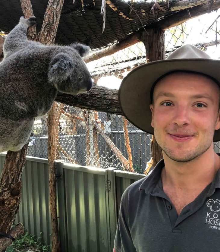Clay Mueller, envoronmental science student, with a koala