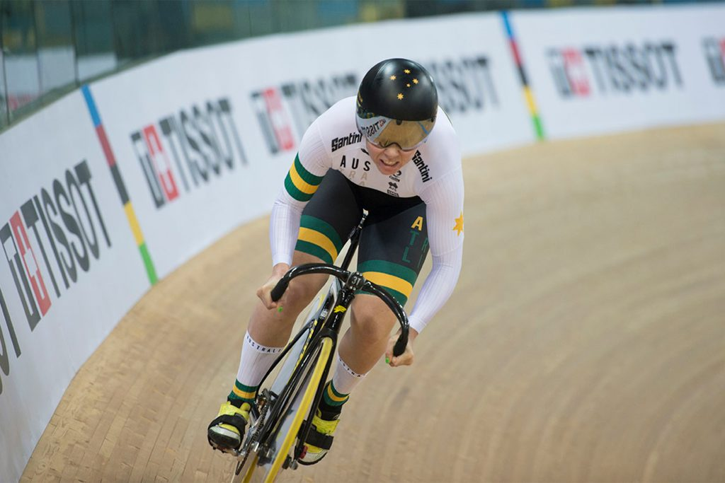 Kaarle McCulloch, world champion track cyclist racing on the track in Australian colours
