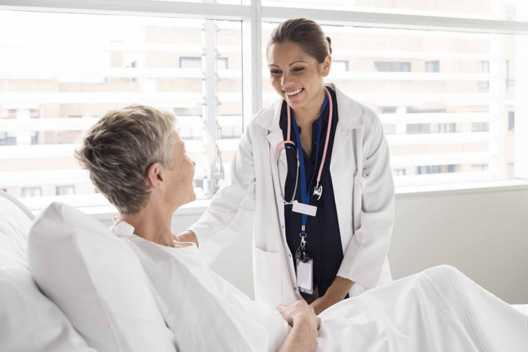 Female doctor talking with a patient in hospital