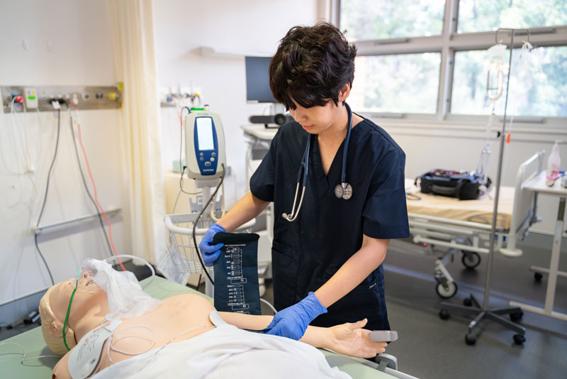 Hands-on medicine learning in the hospital simulation ward.